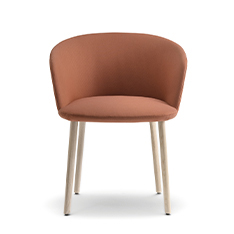 Nym Soft recalls the outlines of the omonymous wooden chairs collection, subtly accentuating and enhancing its comfort.  Armchair with steel frame padded with polyurethane foam of different densities and solid ash wood legs.